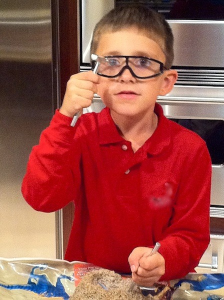 Picture of my little brother testing his safety goggles with a hammer!  Geez!