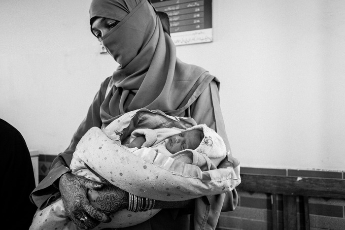 A mother and her child at a government clinic in Korangi Town