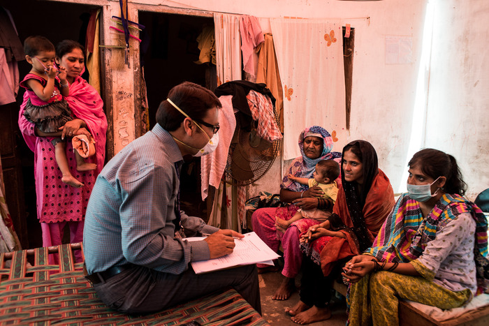 Dr. Naeem Malik, TB field program expert from the Indus Hospital, visits an MDR-TB patient in her home in Korangi Town