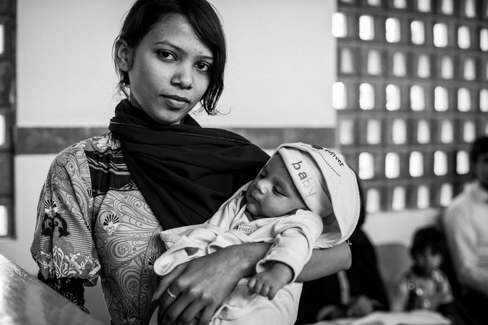 Kiran and her infant at the child immunization center of the Indus Hospital