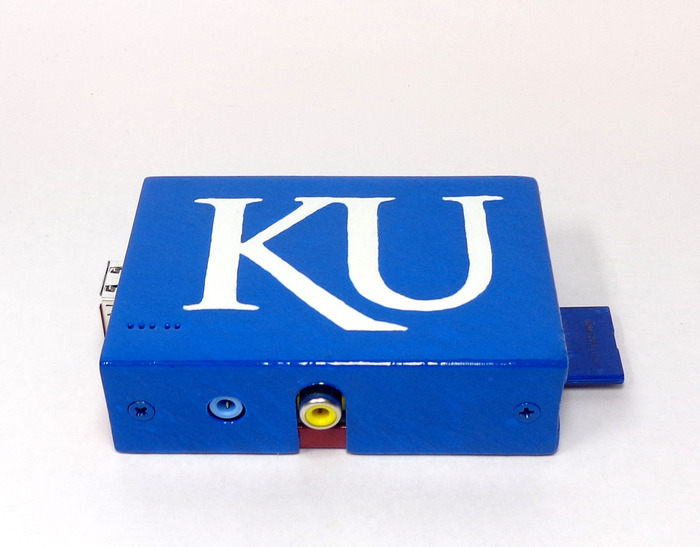 University of Kansas logo with faux oil paint brushed finish