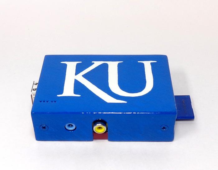 University of Kansas logo with faux oil paint brushed finish