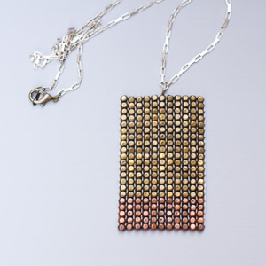 "$45 reward, your choice of finishes. (Shown in brass and copper, with sterling silver chain) Height - 2 1/4""; Width - 1 1/2"""