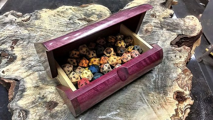 "Assorted Dryad d20's in a custom  ""The Luggage"" Dice Box by Ray Jones."
