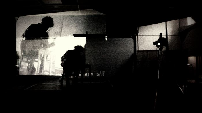 Jonny painting in motion. Live audio-visual art by Peter Farago