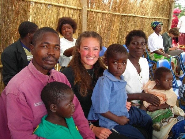 A.J. Walkley with her homestay family in Malawi.
