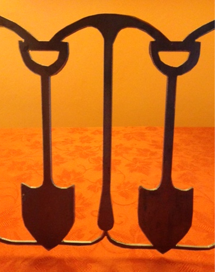 The shovel pick shovel design from the small scale prototype will be used in our rewards.