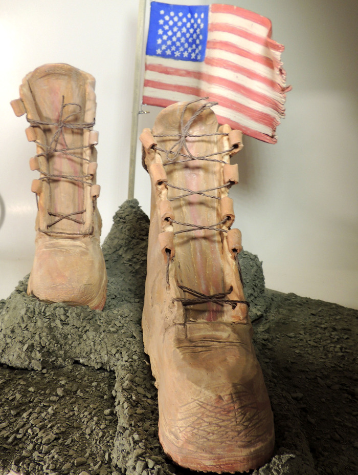 Footsteps for Freedom, multi-media sculpture.  White stoneware, terra cotta, crushed stone, wire, and wooden dowel
