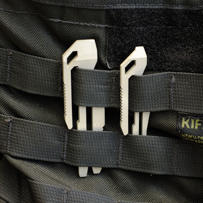 TOOLS ARE SIZED TO BE COMPATABLE WITH MOLLE STRIPS FOUND ON VARIOUS TYPES OF CIVILIAN AND MILITARY GEAR