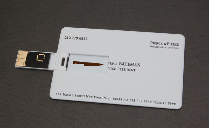 "The 1GB ""Patrick Bateman"" business card, pre-loaded with ""You Are What You Wear"" (featured in the video) plus TWO MORE original American Psycho demos by Duncan Sheik + high res iPhone/iPad skins of ALL THREE posters (below)"