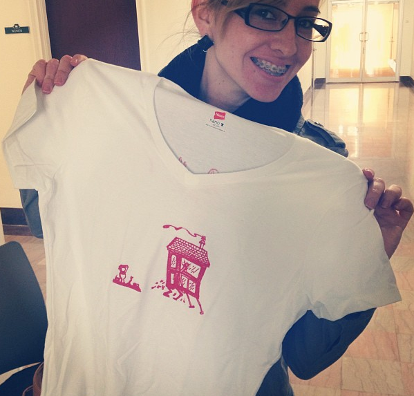 Artist Karina Rocco showing our Dwelling Projects T-shirt