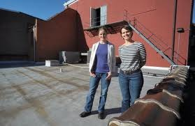 Rachel Hogan Carr and Kate Brandes on the unused rooftop in the rear of our building.