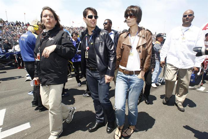 All the big stars love the races! Tom Cruise and Katie Holmes walking the starting grid (photo by Andrew Northcott)