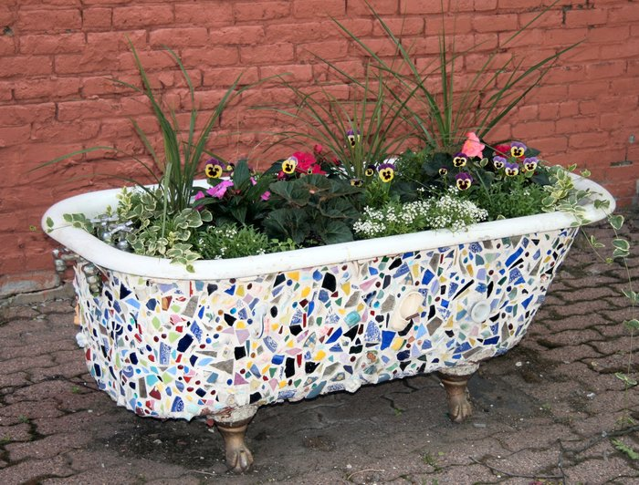 Our Urban Recycle Garden will use found and recycled objects, like bathtubs and tires, as growing containers.