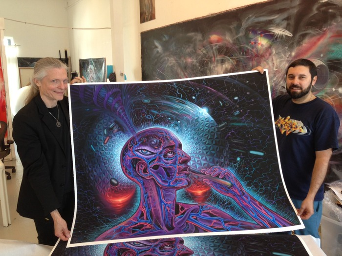 "Alex with Mars-1 and their collaborative painting ""Bicycle Day"""