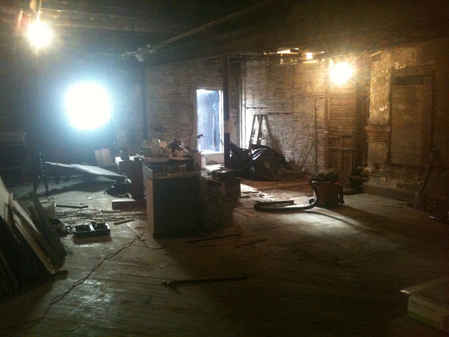 The back half of the loft after demolition: we'd knocked down an office and bathroom, and stripped down walls.