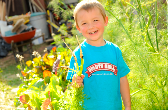 We were assured cute kid photos would sell our project. On a more serious note, this garden will remain self-sustaining until he is in his fifties.