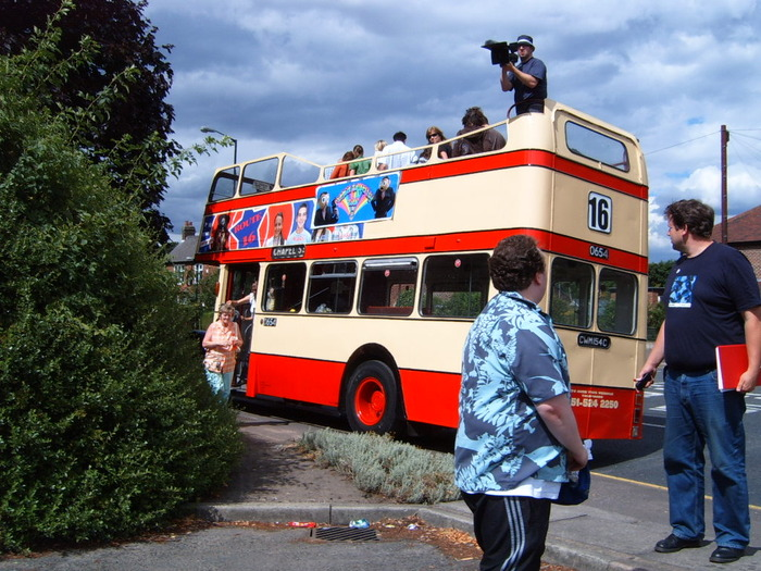 Director Steve Sullivan filming on top of the bus during the Magical Timperley Tour