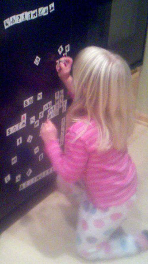 Kids create stories with symbol fridge magnets developing language concepts