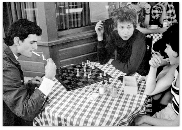 Victor Maymudes and Bob Dylan playing one of many games of chess. Decades later I would personally watch them play chess on tour and at the 18th St. Coffee House.