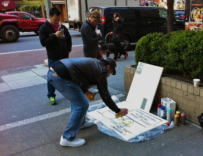 "DE LA VEGA creating his multimedia pieces available as a pledge for ""The Teacher"", on the streets of New York City."