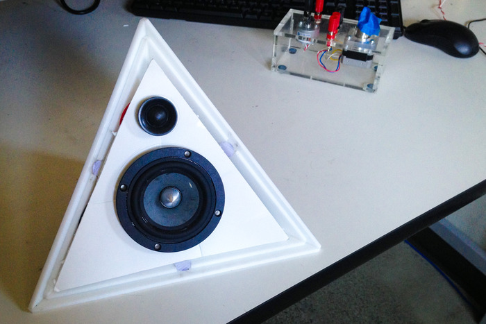 """A peek behind the grille at an early stage working prototype. Below is a 4"""" full-range driver, and above is a 1"""" dedicated tweeter. Each is given parsed signal from an active crossover currently being designed for implementation."""