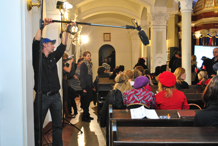Adam trying to get in position to record Katka (in the red) at Purim in the synagogue, Warsaw