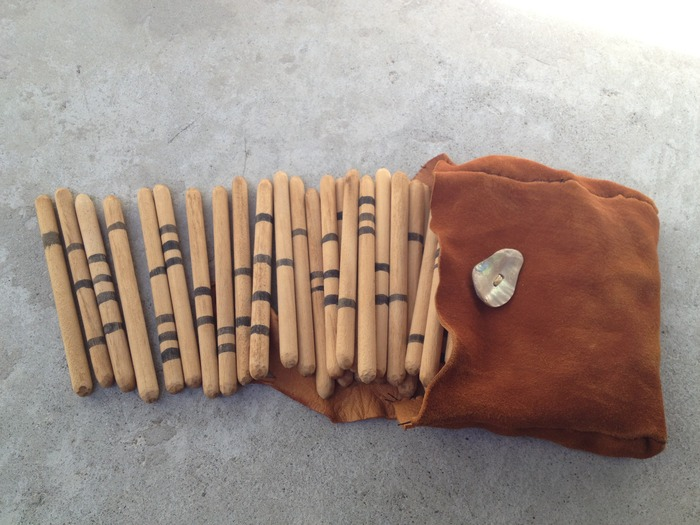 Handmade gambling sticks and deer hide bag with abalone button (Note: Each set will be unique.)