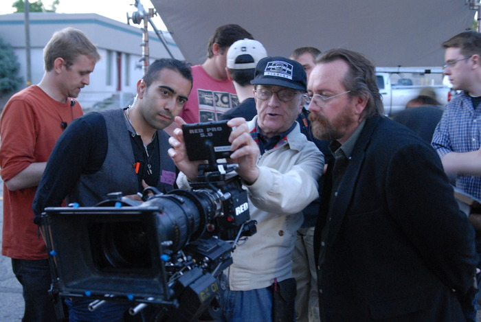 "Filmmaker Richard Dutcher (right) with cinematographer Bill Butler and camera operator Sohrab Mirmontazeri (left) on the set of ""The Boys at the Bar."""