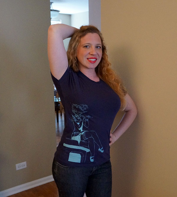 Songbird models a size small. You can indicate your t-shirt size on the survey at the end of the Kickstarter!