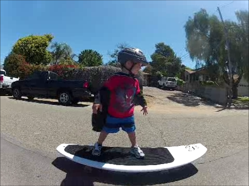 fun for all ages...here a 2 year old surfs the street