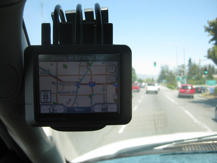 A GPS mounted with FUMM on windshield