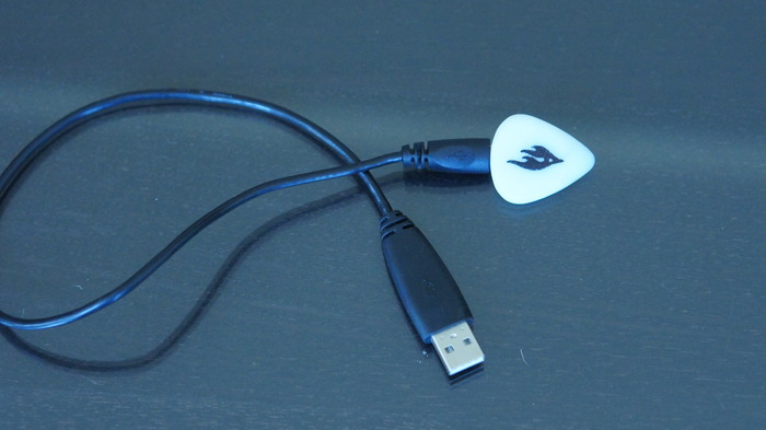 The Firefly Pick's battery is rechargeable using standard a micro-USB cable