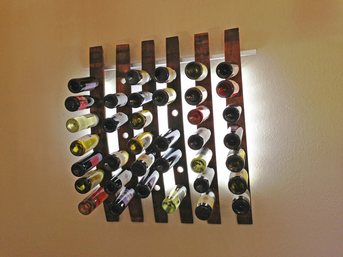 Lumi Wine Wall with 6 wine staves holding 42 bottles of wine includes all hardware, 144 SuperBright LEDs and six 12V wall transformers or six battery packs.  Once the project ends the six Lumi Wine Wall will retail for $660.00.