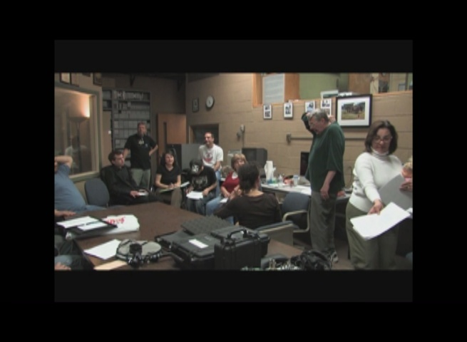 "Production meeting for ""The Journey"".  Fred Barzyk is in the green shirt."