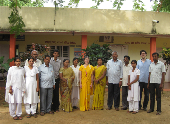 Annie, her brother Alex, and staff members pose for a photo at Dindavara primary health center in rural southern India