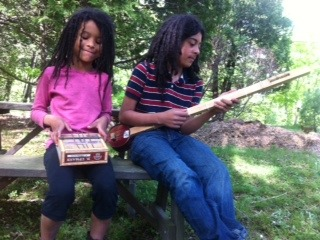 Zzoe's students playing their handmade instruments