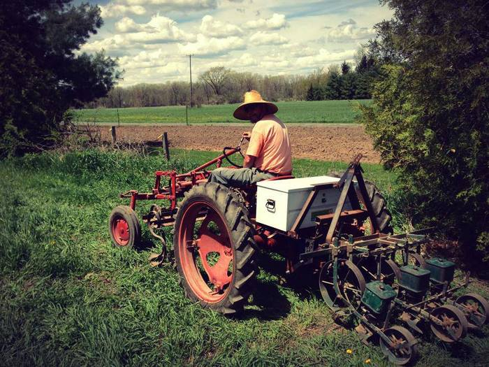 Farmer Paul on our electric, solar-powered tractor!
