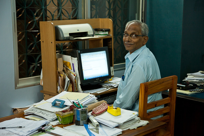 M. Ghayasuddin at his desk in Saidpur. February 2013.