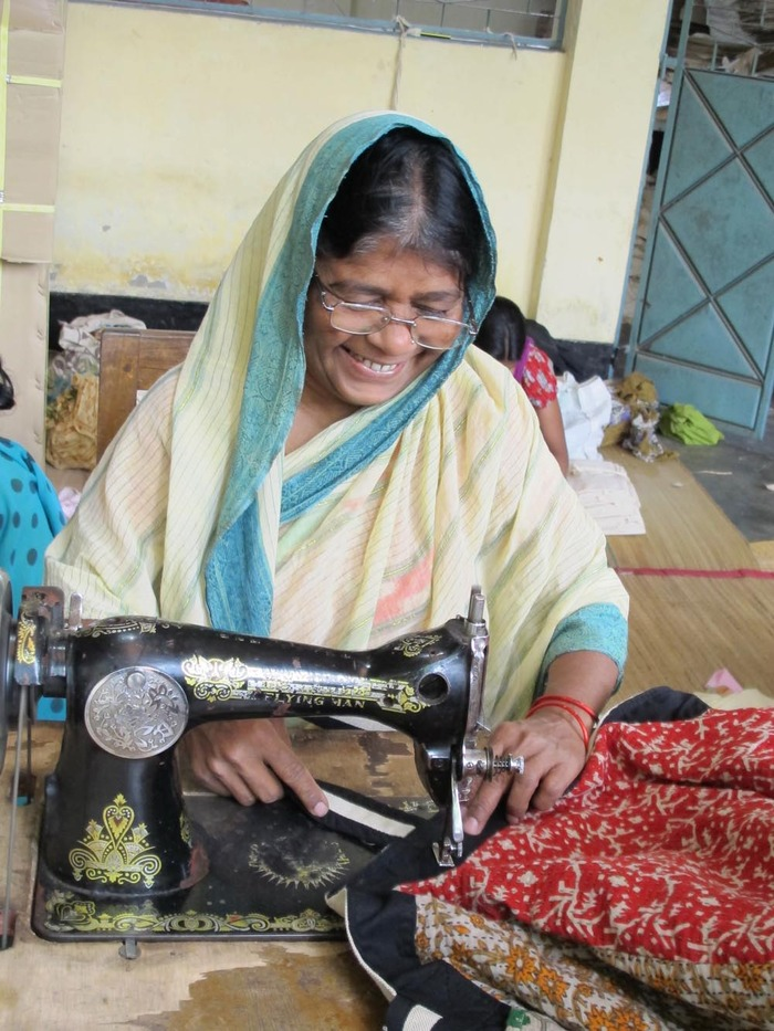Putting the finishing touches on an OM bag prototype - Saidpur, Bangladesh. February 2013.