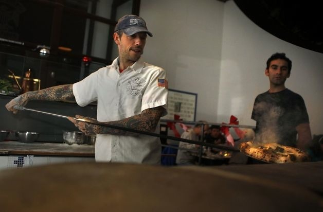 Anthony at the oven of Una Pizza Napoletana, Image: Liz Hafalia