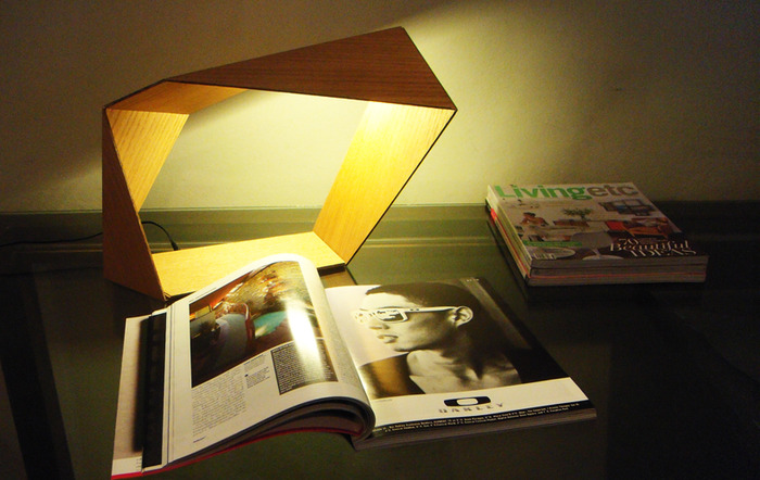 "The ""Loop"" lamp used as a reading lamp."