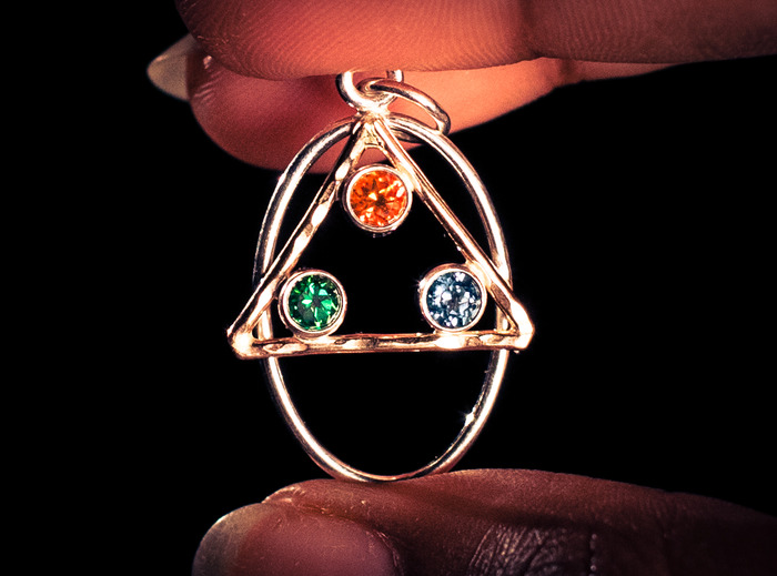 "The original ""Universe"" design by Sam, with three topaz jewels."