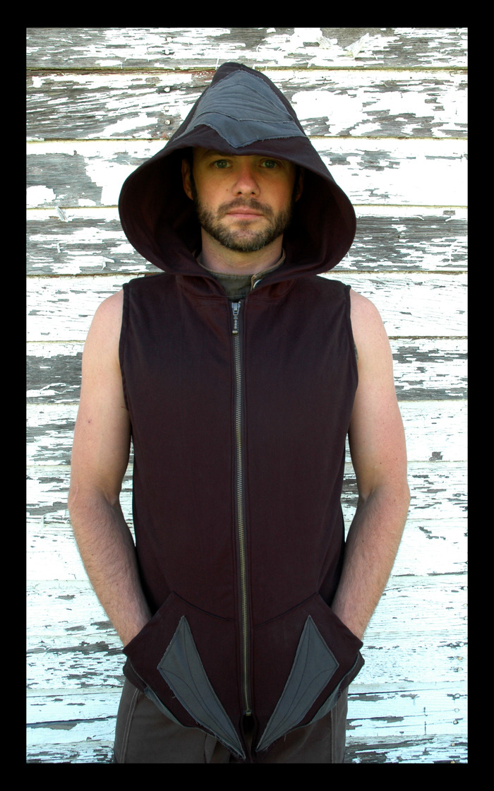 $135~ Pachas signature MENS hooded vest, with pockets on the front, a sturdy Ykk zip, as well as over size hood. Has unique symbol stitch work on the front and back. Comes in Black base unless you request another color.