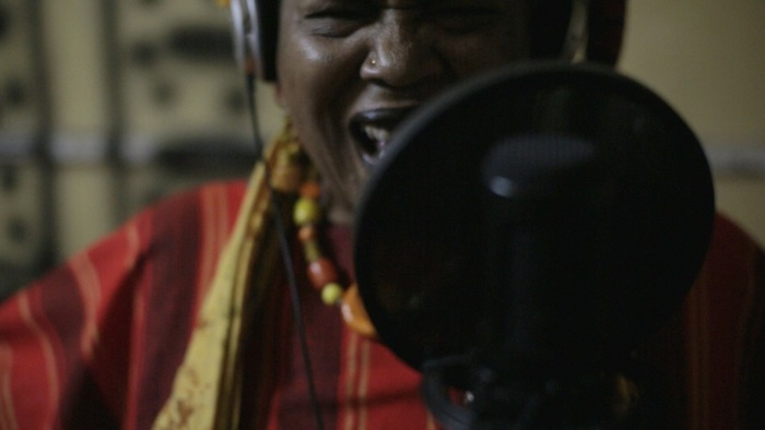 Mama C belting it out at Watenga Studios in Arusha, Tanzania.