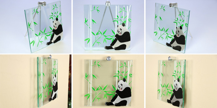 "Size: 10"" X 10"" X 2"". The bamboo is engraved on the front of the glass with various leaves painted green.  The panda is cut out of aluminum material, anodized black, and then engraved to create white patches with additional paint added for final detailing"