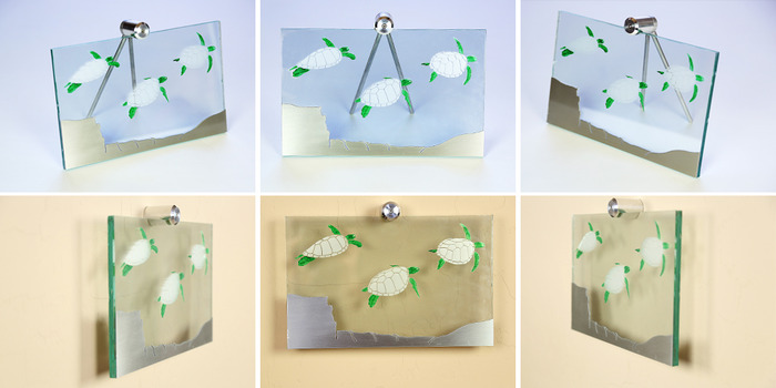 "Size: 11"" x 7"" x 2"". Engraved sea turtles on the front of the glass with green painted accents.  A cut piece of line-grained aluminum creates the sea floor."
