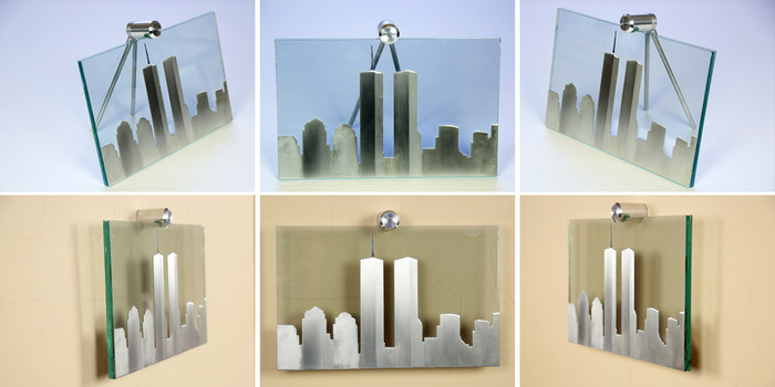 "Size: 11"" x 7"" x 2"". The skyline is cut out of aluminum material with a line-grain sanding process to add characteristics to each building.  The antenna on top is sandblasted on the front of the glass and painted black."