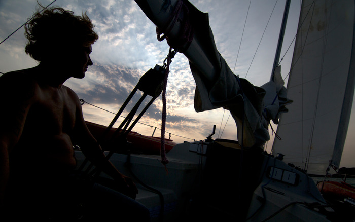 Jon at the helm during sunset