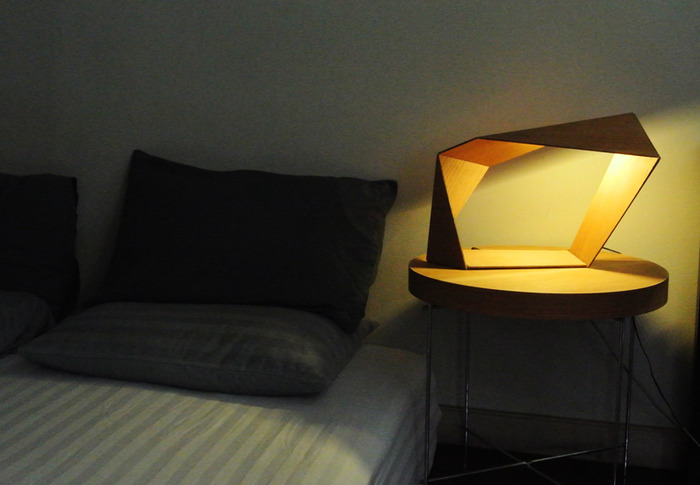 """Loop"" lamp at bedside."